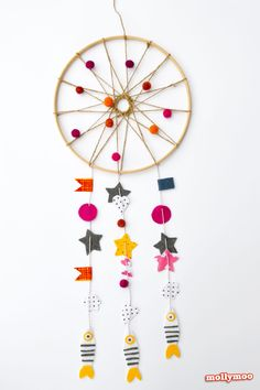 How to make a dreamcatcher with a hoop, twine and some felty bits and bobs | MollyMooCrafts.com