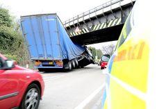 Stuck truck: Lorry driver jams HGV under bridge