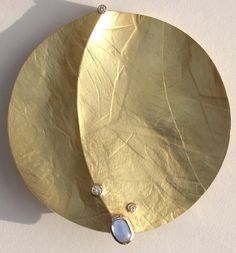 Eve Llyndorah Designs~18k yellow gold disc with sapphire cabochon and diamonds