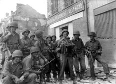 June 1944- American Troops in town after D-Day Landing celebrating. 80th Infantry Division