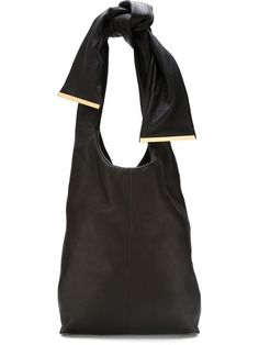 Shop Marni bow handle shoulder bag in Fusco from the world's best independent boutiques at farfetch.com. Shop 400 boutiques at one address.