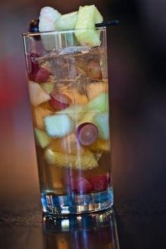 Curacao Rum Punch (.5 Tbsp Sugar 2 or 3 Dashes Lemon Juice 1 oz Soda Water 1 oz Cognac 2 oz Orange Liqueur  1 oz Jamaican Rum)