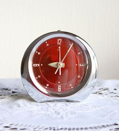 Vintage alarm clock Unused 1970s metal clock Wind up mechanical clock Chinese desk clock Old table clock Diamond China Red and silver retro by VintageCorner42 on Etsy https://www.etsy.com/listing/242172646/vintage-alarm-clock-unused-1970s-metal