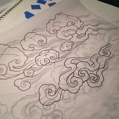 Tibetan clouds-must incorporate this into my snow leopard tattoo design!