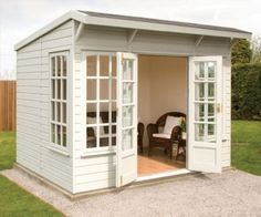 shed, cute not sure how practical but could work with it.  just shorten the windows to add cabinets underneath. love the double doors and roof.  simple enough to build myself