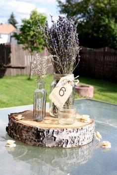 lavender wedding centerpiece with wooden stump   Deer Pearl Flowers