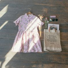 Peter pan collar flower print dress & Apolis market bag. A perfect spring combination: www.oliveclothing.com
