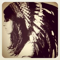 American Indian headdress.... Love it!  @Amanda Norberg -- how about a headdress instead of a crown?