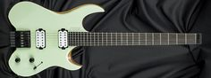 Kiesel Guitars V6, seafoam green (SG), clear satin finish (CS), rear natural clear finish (RNC), swamp ash body (ASH), swamp ash top (AT), 5 piece maple w/walnut strips (5MW), black ebony fingerboard (EFB), no top inlays side dots only (NIN), Luminlay side dots (SDL), tung oil finish on back of neck (TN), stainless frets (STF), 14