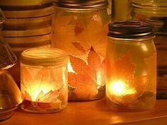 In this post on fall crafting with autumn leaves, Mod Podge and food coloring, Pam of Gingerbread Snowflakes waxes poetic on the multiple po. Autumn Crafts, Holiday Crafts, Holiday Fun, Fall Halloween, Halloween Crafts, Happy Halloween, Candle Jars, Mason Jars, Candle Holders