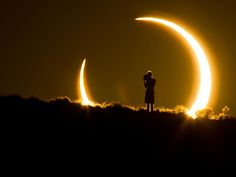 An observer in Colorado stands framed by a partial solar eclipse in a picture taken last week and submitted to National Geographic's My Shot ...