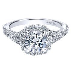 14kt white gold semi-mounting engagement ring, halo style, containing 0.65ctw of round brilliant cut diamonds, SI1 clarity, G-H color, shared prong set. The ring is made to fit a 6.5mm or 1.00ct cente
