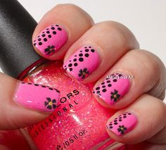 Pink, glitter, dots and the flowers. I kind of like this. Maybe on one or two fingers. Not all at once.