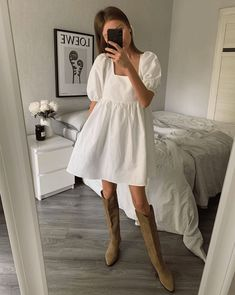 The easiest way to soften a pair of knee high boots in the spring is to pair them with fluid textures. Nothing looks quite as pretty as a white dress. 70s Fashion, Look Fashion, Fashion Outfits, Womens Fashion, Fashion Design, Fashion Mask, Fashion 2020, Fashion Pants, Dress Fashion