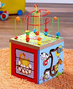 """Stimulate your child with all the entertaining activities on this 5-In-1 Wooden Learning Center. Safe and non-toxic, it has 5 activity centers designed to make learning fun. 7-7/8"""" sq. x 14""""H. Wooden with metal and plastic accents. For ages 18 months and"""