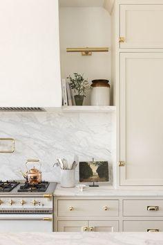 home decor tips spacious kitchen design // white and cream neutral kitchen decor // white cabinets // brass cabinet accents Home Decor Kitchen, New Kitchen, Kitchen Interior, Home Kitchens, Devol Kitchens, All White Kitchen, Rustic Kitchen, Black And Cream Kitchen, Modern Kitchen Wall Decor