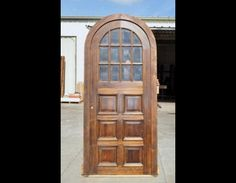 Arch Solid Single Door with panels and beveled glasses. It is pre-hung on its hardwood frame. It comes with beveled glasses installed. Pre-finished and ready to install.
