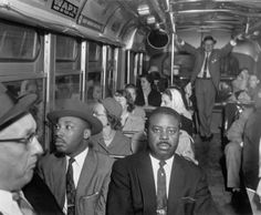 Dr. Martin Luther King Jr. and Rev. Ralph Abernathy (Montgomery, Alabama, 1956) ride on one of the first desegregated buses after the Montgomery Bus Boycott.