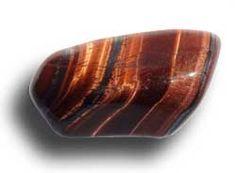 œil de taureau naturel (hématite donne la couleur). La Crocidolite d'un oeil de faucon chauffées par traitement thermique donnent un oeil de taureau.