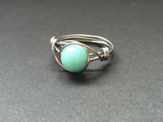 Brazilian aquamarine ring, hand wrapped in stainless steel. I used stainless steel to wire wrap the stone. Stainless steel is by far the best