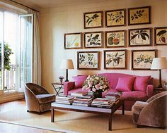 How to make your space take center stage with botanical art and a pop of color, and calculated design tips. Learn how to ditto this space via interior designer @FieldstoneHill Design, Darlene Weir Design, Darlene Weir #pinksofa #botanicalprints #botanicalart #ditto #symmetry #livewithbeauty #bold