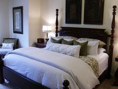 Andrea M: Master Bedroom  Black posted bed, white & green bedding and green silk pillows.