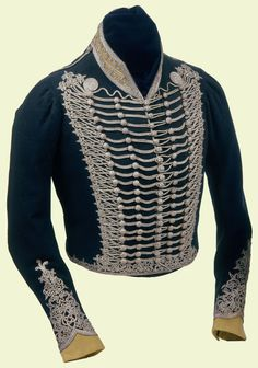 1800 Worn by the Prince Regent as Colonel of the 10th Light Dragoons, an office he held from 1796-1819.  Description:  Dark blue uniform jacket, white silk lined, yellow stand collar with silver lace, twenty one lines of silver lace across chest, five rows wooden buttons covered with silver lace, yellow cuffs.