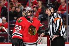 CHICAGO, IL - JANUARY 24: Goalie Corey Crawford #50 of the Chicago Blackhawks talks with referee Dave Lewis #46 in the second period against the Tampa Bay Lightning at the United Center on January 24, 2017 in Chicago, Illinois. (Photo by Bill Smith/NHLI via Getty Images)