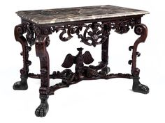 Walnut and marble console table, circa 1720.