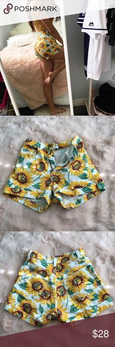 American Apparel Sunflower Denim Shorts American Apparel Sunflower Denim Shorts  High waisted Size 24/25 In great condition  I love these but they're a bit too small for me (I'm a 25/26 W usually) Jean shorts material with bright yellow and green floral print, very on trend for 70s festival summer looks Such a cute statement piece to liven up some basics American Apparel Shorts Jean Shorts