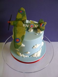 It isn't every day you're asked to make a cake for a veteran fighter pilot, so it was a tremendous honour to make this Spitfire cake. It was a tall triple layer chocolate cake, sandwiched with lashings of salted chocolate buttercream and. Triple Layer Chocolate Cake, Salted Chocolate, Baby Cookies, Baby Shower Cookies, Planes Cake, Airplane Cakes, Gorgeous Cakes, Amazing Cakes, 40th Birthday Cakes For Men