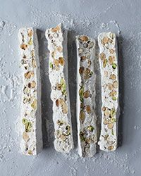 Almond-Pistachio Nougat Recipe on Food & Wine --- I hope this tastes like the torrone I used to get at Christmas Candy Recipes, Wine Recipes, Dessert Recipes, Pistachio Nougat Recipe, Torrone Recipe, Yummy Treats, Sweet Treats, Yummy Food, Gluten Free