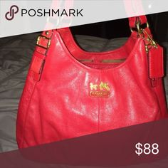 2 Strap Coach Purse Red, used. A few years old. No dirt or wear marks inside the pockets except a pen mark Coach Bags Shoulder Bags
