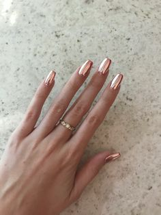 Rose gold chrome gelish polygel nails by @blyss_beauty  achieved by using a fluorescent pink base under silver chrome power