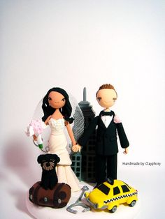 New York City backdrop behind the couple Customized wedding cake topper with a yellow cab