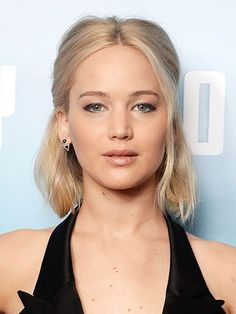 Valentine's Day Beauty Inspiration - Jennifer Lawrence's black liner and easy half-up hairstyle | allure.com