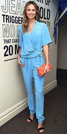 Stacy Keibler perfectly offset her all-over periwinkle blue look with a bright orange clutch, both by Rebecca Minkoff, and black strappy Chelsea Paris heels. Orange Clutches, Pleated Jumpsuit, Stacy Keibler, Jennifer Connelly, Eva Longoria, Kate Hudson, Gal Gadot, Classy And Fabulous, Rebecca Minkoff
