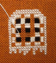 The back panel of the Gingerbread Stitching House by Victoria Samplerthat I am stitching has a hardanger window, which is then backed with contrasting fabric  - see my blog for my progress.