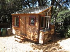 A 120-square-foot house with loft, hand-built by an artist, with salvaged redwood siding.