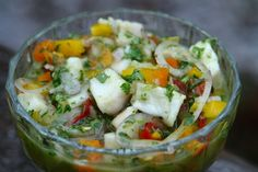 Ceviche made with fish cooked in lime juice with garlic, hot peppers and salt, mixed with shallots, tomatoes, peppers, and cilantro.
