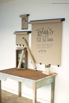 This wall-mounted paper roll makes to-do lists look good. Use the kraft  paper to create a weekly menu, scribble a note, or jot down reminders and  other to-dos. Each wall mount comes with one roll of kraft paper and four  brass clips to keep your paper straight and smooth. Replacement rolls sold