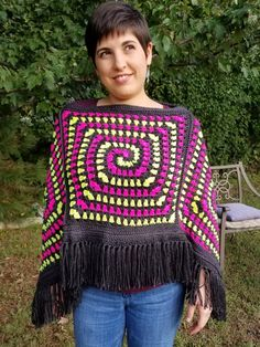 Welcome to the finishing details of the Spiral Illusion Poncho. Now that you have your basic poncho shape (you can find those instructions here) we can finish the neckline and… Half Double Crochet, Single Crochet, Crochet Hooks, Free Crochet, Granny Square Poncho, Ladies Poncho, Crochet Poncho Patterns, Slip Stitch, Pink Yellow