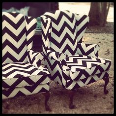 Black and white chevron print wingback chairs.