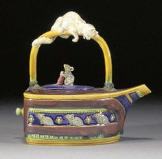 A Minton majolica cat and mouse teapot and cover
