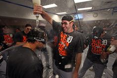 Playoff-clinching celebrations | Sep 25, 2013; Minneapolis, MN, USA; Detroit Tigers starting pitcher Justin Verlander (35) drops champagne over a team mate after winning the Central Division Championship at Target Field. The Tigers won 1-0. (Jesse Johnson-USA TODAY Sports)