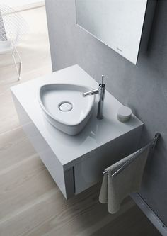 The Starck 1 washbasin in the shape of a rounded down triangle.