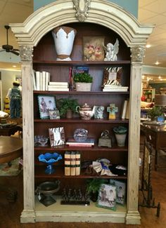 Large beautiful bookcases, hold treasures and collections that are more dramatic when showcased together.