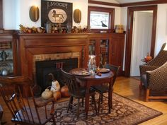 Love this sitting room. Cozy fireplace and table.