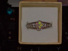 LOOK!!!!!! A STUNNING STERLING SILVER WHITE FIRE OPAL AND ICY WHITE TOPAZ ENGAGMENT RING SIZE 8