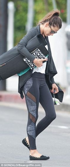 Fit and fabulous: The Victoria's Secret Angel donned a pair of figure-hugging leggings and...